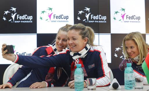 United States team player CoCo Vandeweghe, centre, takes a selfie with team captain Kathy Rinaldi, right, and Alison Riske prior to the drawing ceremony, in Minsk, Friday, Nov. 10, 2017. The Fed Cup final matches between Belarus and USA will take place Nov. 11 - 12, 2017.