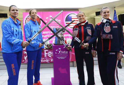 Belarus' team players Lidziya Marozava, Vera Lapko, United States team players Shelby Rogers, Alison Riske, from left to right, pose for photo after drawing ceremony, in Minsk, Friday, Nov. 10, 2017. The Fed Cup final matches between Belarus and USA will take place Nov. 11 - 12, 2017.