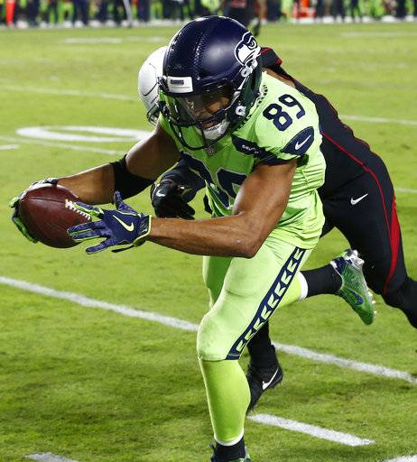 Seattle Seahawks wide receiver Doug Baldwin (89) is knocked out of bounds by Arizona Cardinals safety Budda Baker (36) during the second half of an NFL football game, Thursday, Nov. 9, 2017, in Glendale, Ariz.