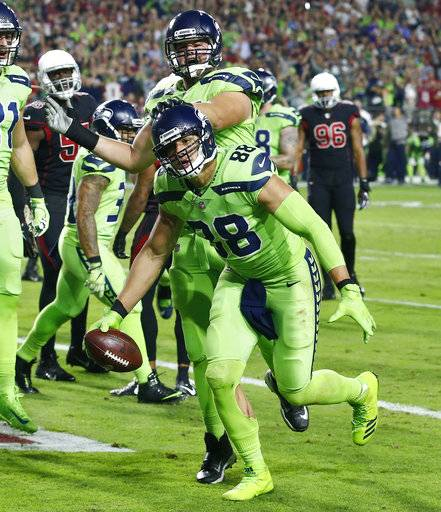Seattle Seahawks tight end Jimmy Graham (88) celebrates his touchdown catch against the Arizona Cardinals during the second half of an NFL football game, Thursday, Nov. 9, 2017, in Glendale, Ariz.