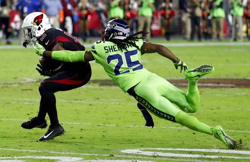 Seattle Seahawks cornerback Richard Sherman (25) tackles Arizona Cardinals wide receiver John Brown (12) during the second half of an NFL football game against the Arizona Cardinals, Thursday, Nov. 9, 2017, in Glendale, Ariz. Sherman walked to the bench after being injured on the play.