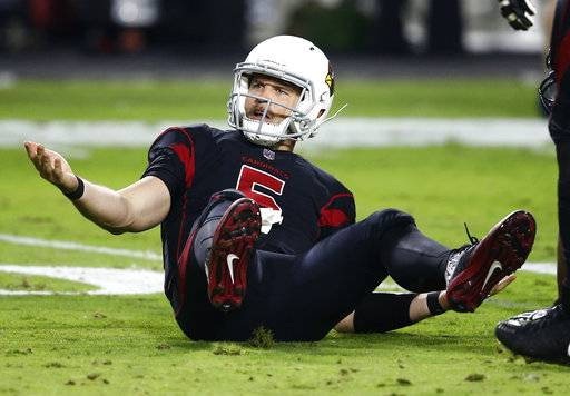 Arizona Cardinals quarterback Drew Stanton (5) look for a roughing call against the Seattle Seahawks during the second half of an NFL football game, Thursday, Nov. 9, 2017, in Glendale, Ariz.