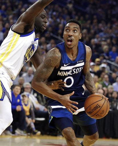 Minnesota Timberwolves' Jeff Teague, right, looks to shoot against Golden State Warriors' Draymond Green (23) during the first half of an NBA basketball game Wednesday, Nov. 8, 2017, in Oakland, Calif.