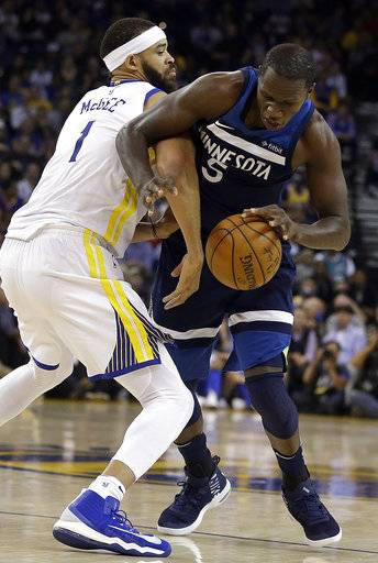 Minnesota Timberwolves' Gorgui Dieng, right, is fouled by Golden State Warriors' JaVale McGee during the first half of an NBA basketball game Wednesday, Nov. 8, 2017, in Oakland, Calif.