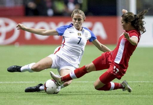 Canada's Jessie Fleming, right, slides to take the ball away from the United States' Abby Dahlkemper during the second half of an international friendly soccer match, Thursday, Nov. 9, 2017, in Vancouver, British Columbia. (Darryl Dyck/The Canadian Press via AP)