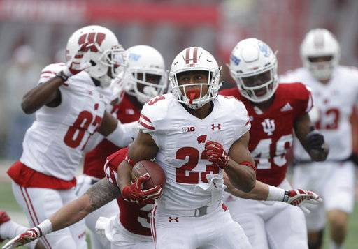 FILE - in this Saturday, Nov. 4, 2017, file photo, Wisconsin running back Jonathan Taylor (23) runs during the first half of an NCAA college football game against Indiana in Bloomington, Ind. Taylor, the Big Ten's leading rusher, will play in the biggest game yet of his first college season on Saturday against Iowa. (AP Photo/Darron Cummings, File)