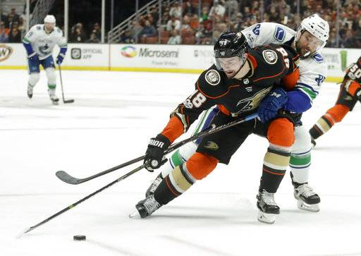 Anaheim Ducks center Logan Shaw vies for the puck with Vancouver Canucks center Sam Gagner during the second period of an NHL hockey game in Anaheim, Calif., Thursday, Nov. 9, 2017.