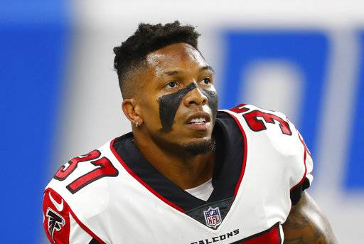 FILE - In this Sept. 24, 2017, file photo, Atlanta Falcons free safety Ricardo Allen warms up before an NFL football game in Detroit. When the Cowboys and the Falcons meet Sunday in a critical NFC match, the winner will be in solid position for a run toward the playoffs.