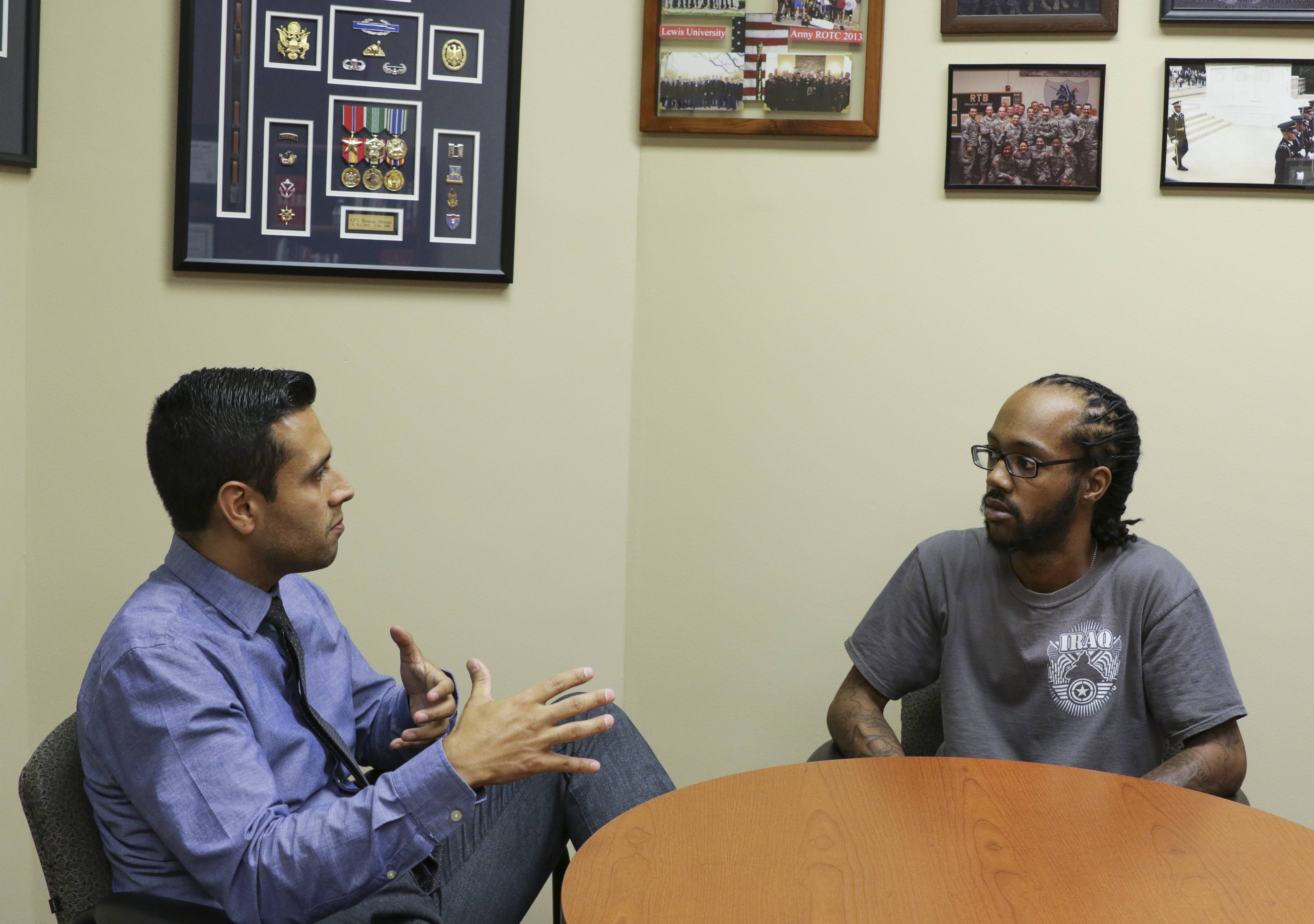 Darian Blanks, right, an Iraq war veteran, talks with Roman Ortega Jr, director of Veteran's Affairs at Lewis University in Romeoville. Blanks twice tried to commit suicide but has turned his life around and now wants to counsel other veterans.