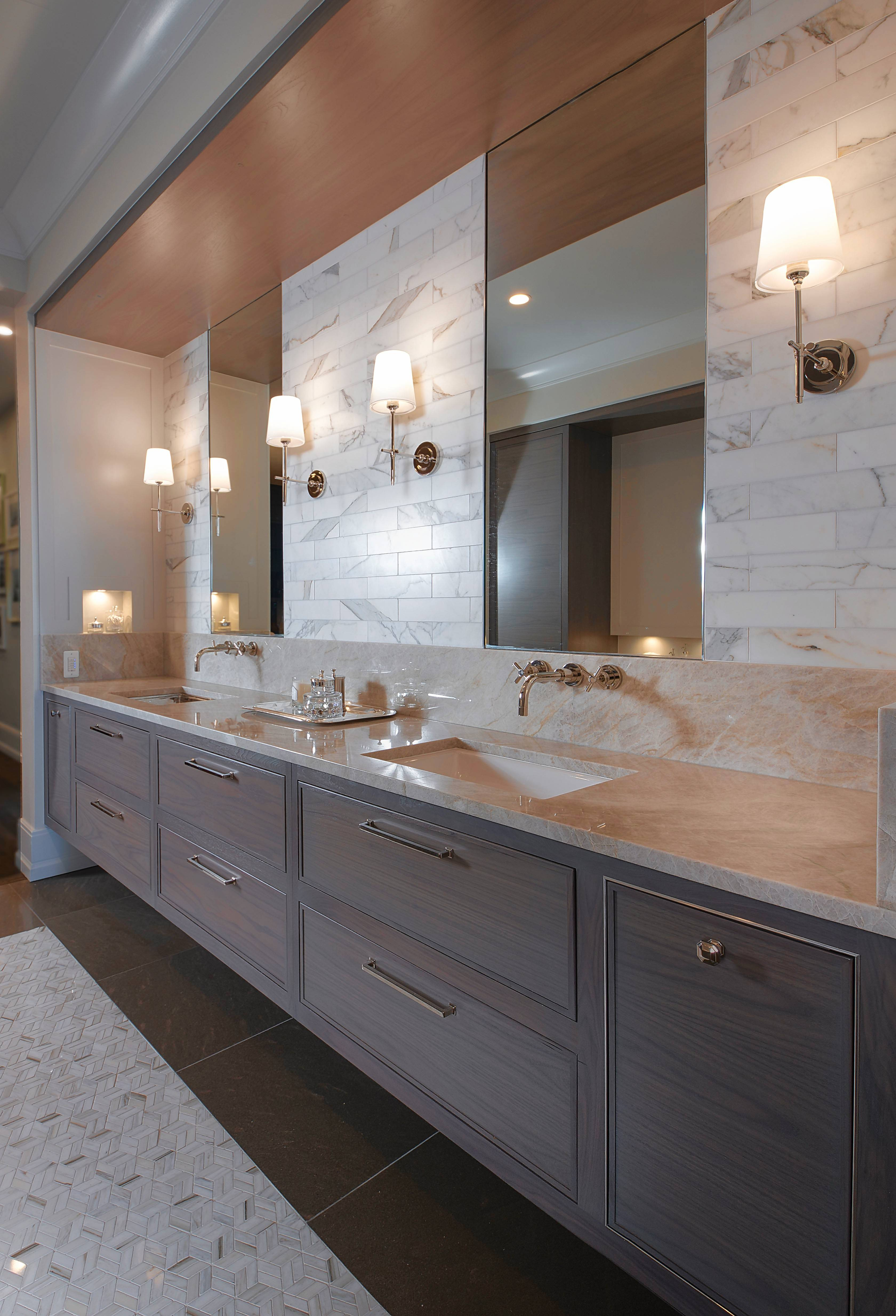Over-the-mirror lighting, or bath bars, are rarely flattering for anyone. Instead, try installing sconces 60--68 inches off the floor on either side of a mirror for better lighting and a more sophisticated look.