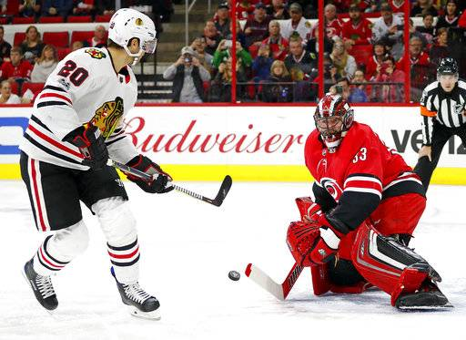 Chicago Blackhawks' Brandon Saad (20) fails on a penalty shot to get the puck past Carolina Hurricanes goalie Scott Darling (33) during the first period of an NHL hockey game, Saturday, Nov. 11, 2017, in Raleigh, N.C.