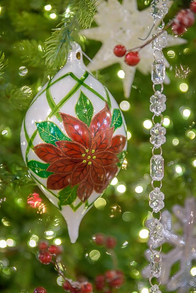 A glass ornament from the Winter Garden collection.