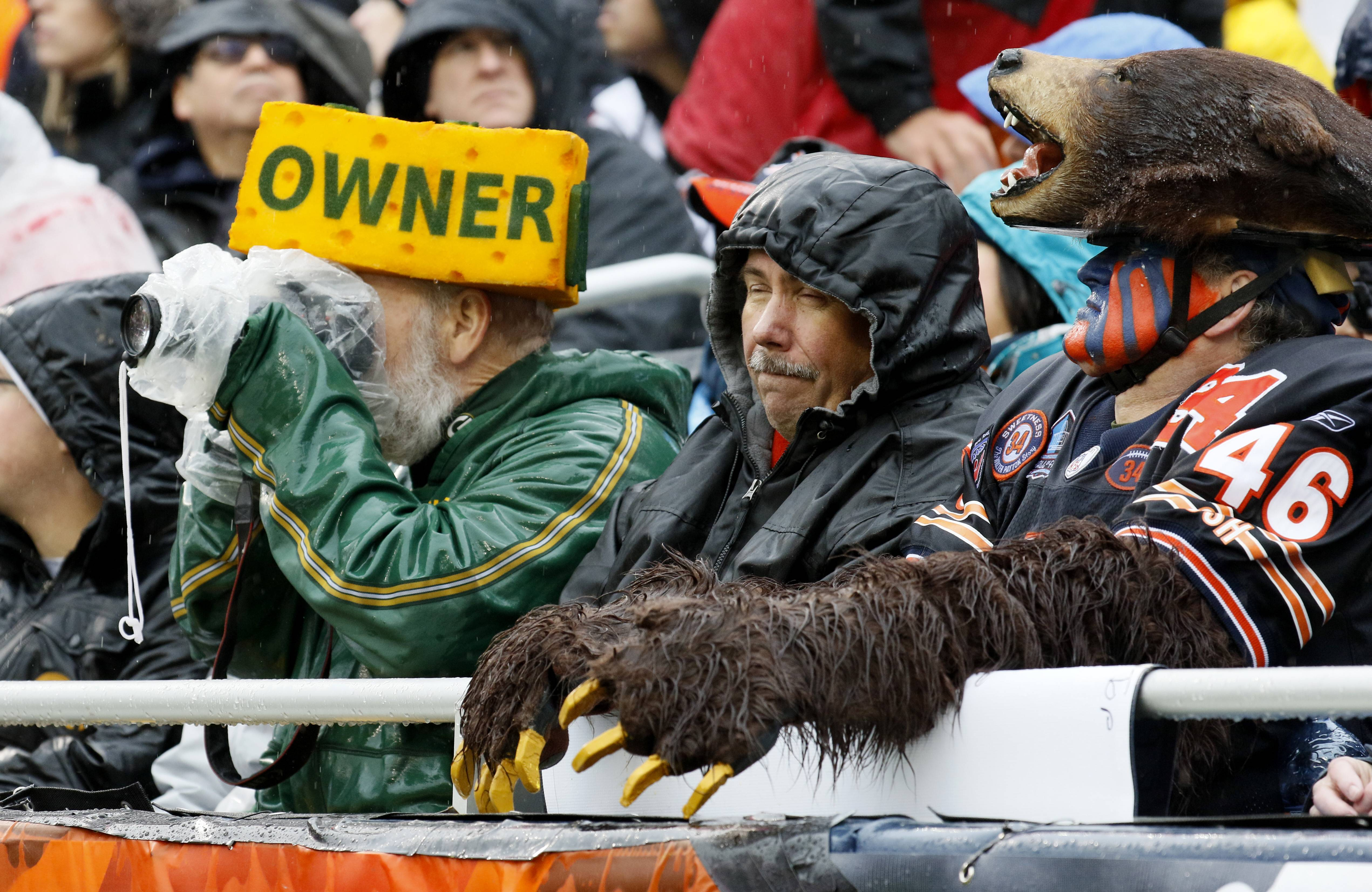 Chicago Bears and Green Bay Packers fans brave the rain, November 12, 2017, at Soldier Field.