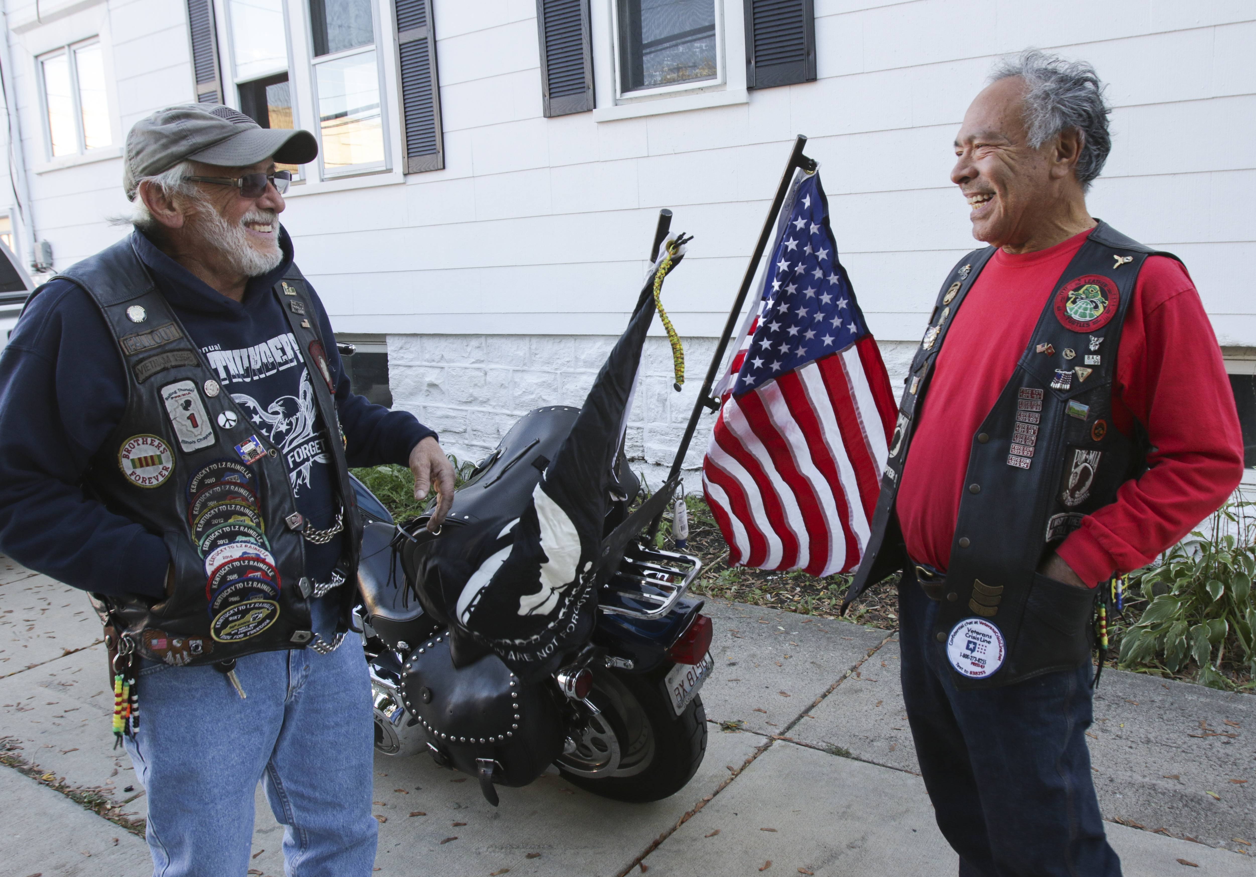 "Vietnam veteran Bill ""Fallout"" Atkinson of Glendale Heights, left, has found a new brotherhood in Rolling Thunder Illinois Chapter 1 with members such as Manuel Lopez of Naperville. They promote the Veterans Crisis Line, (800) 273-8255, text 838255 or VeteransCrisisLine.net."