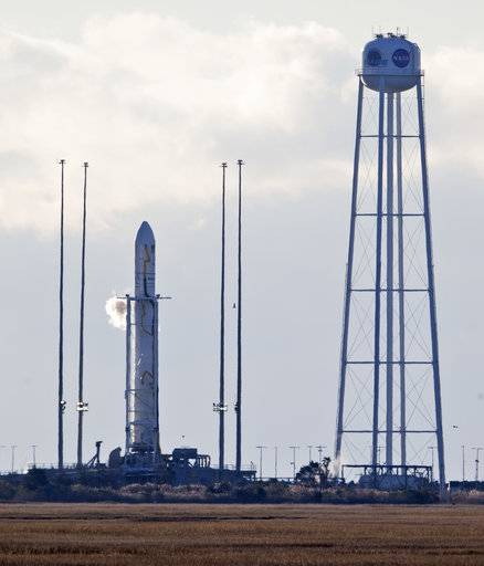 Orbital ATK's Antares rocket sits on the 0A launch pad moments before a scheduled launch at the NASA Wallops Island flight facility in Wallops Island, Va., Saturday, Nov. 11, 2017. The launch of the rocket which is carrying cargo to the International Space Station was postponed due to aircraft in the area.