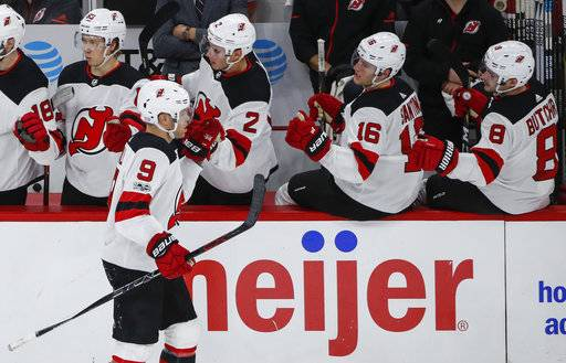 New Jersey Devils left wing Taylor Hall (9) celebrates with teammates after scoring against the Chicago Blackhawks during the second period of an NHL hockey game Sunday, Nov. 12, 2017, in Chicago.