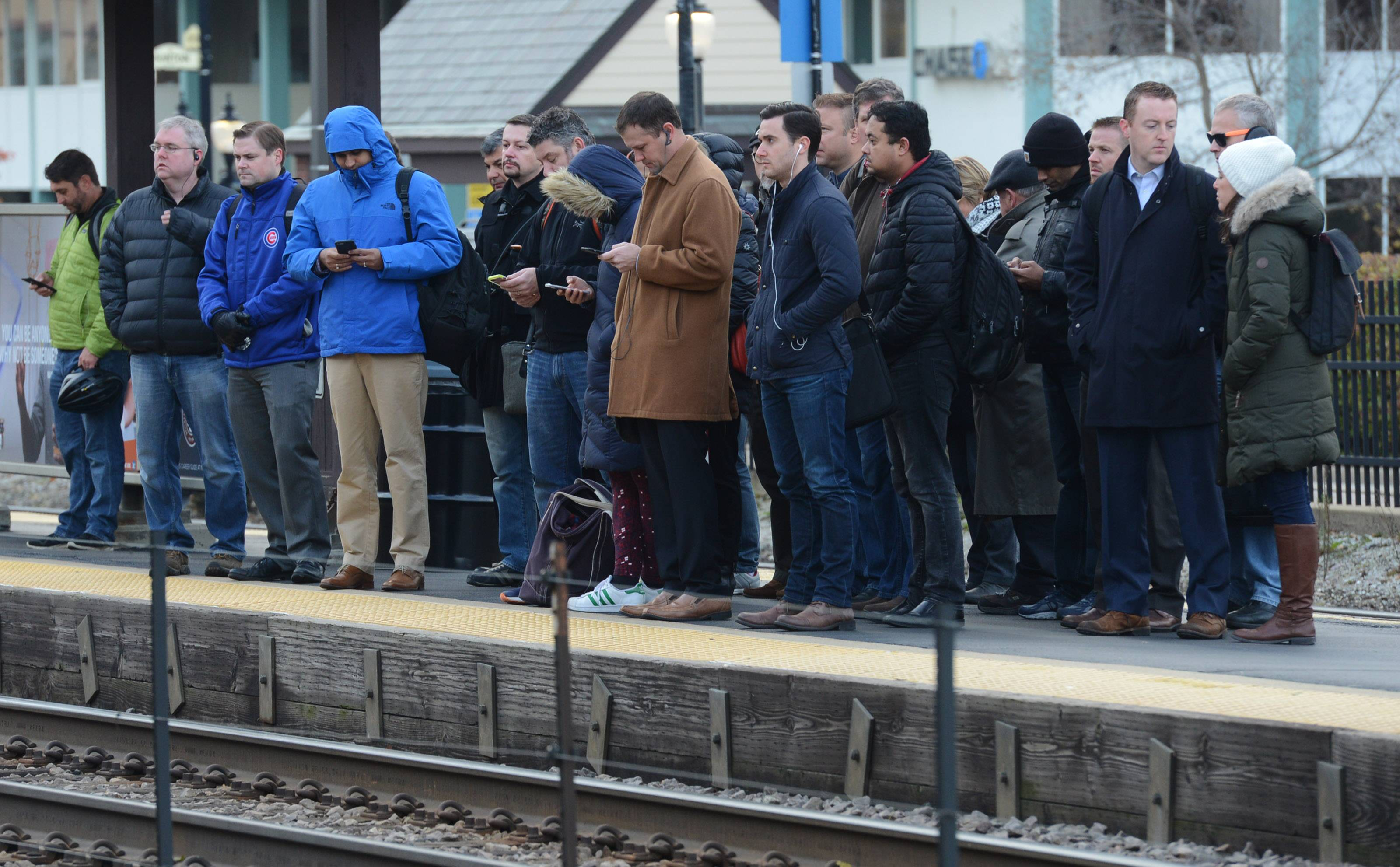 Commuters line the platform while awaiting the arrival of an inbound Metra/Union Pacific Northwest Line train at Arlington Heights.