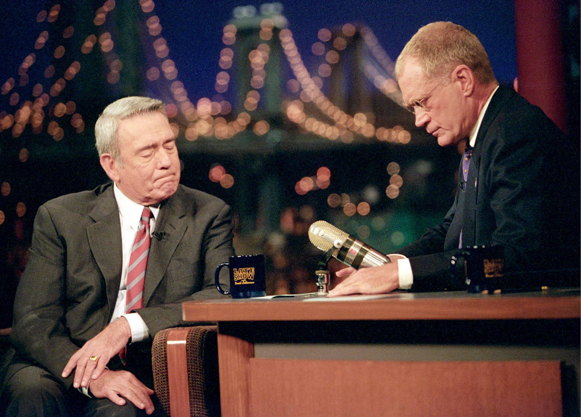 "Dan Rather is comforted by host David Letterman on Sept. 17, 2001, after Rather was overcome by emotion while discussing the World Trade Center and Pentagon attacks on ""The Late Show With David Letterman."""