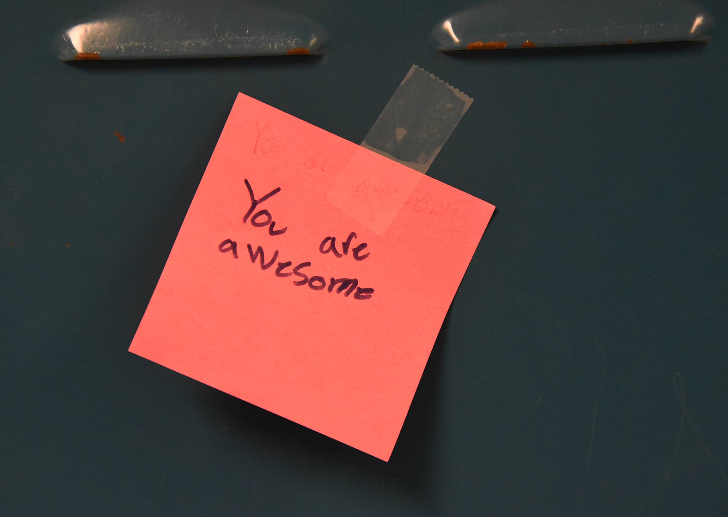 Field Elementary School fourth-graders taped Post-it notes on lockers Monday at London Middle School in Wheeling. The effort was part of World Kindness Day.