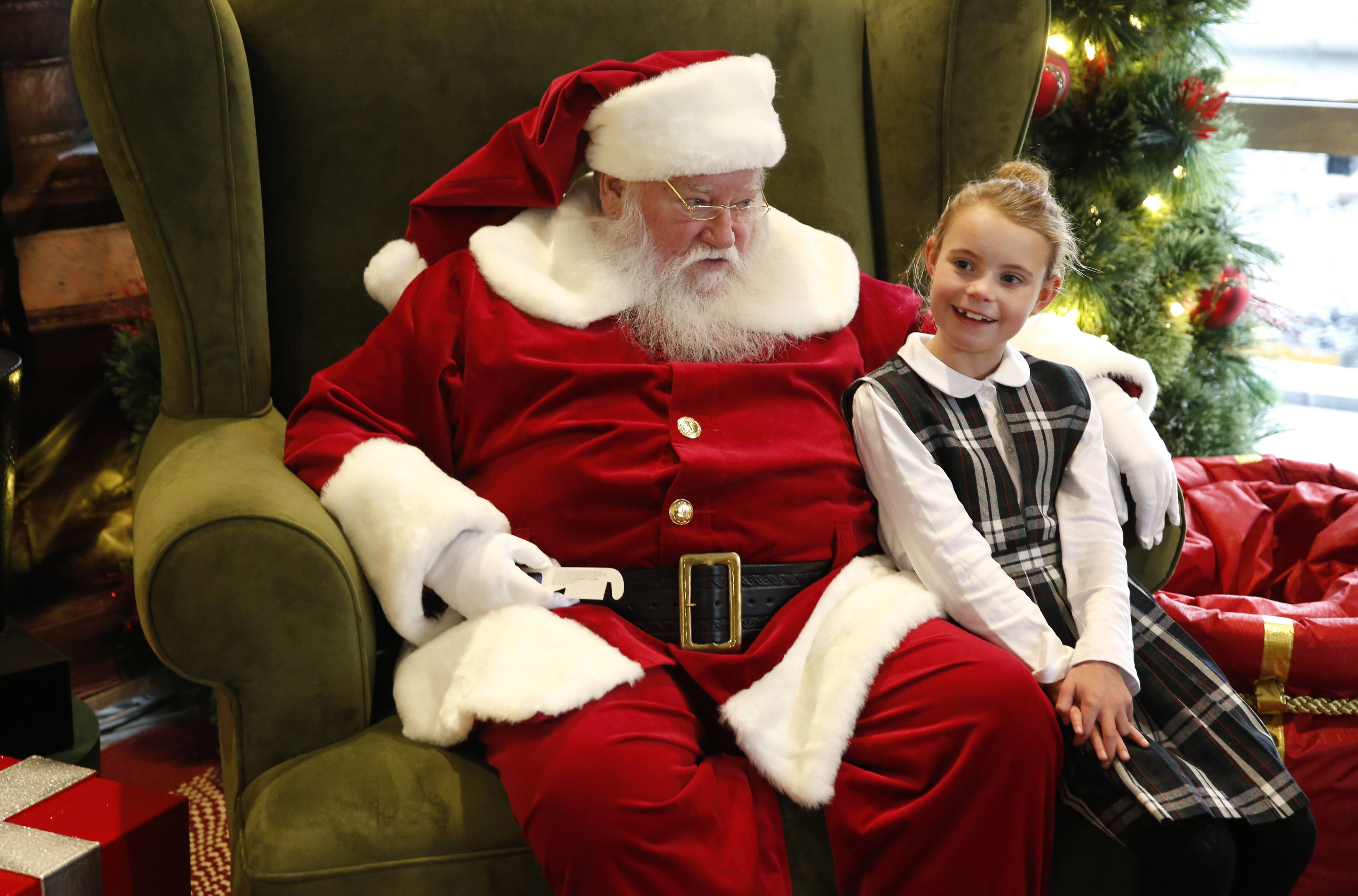 Katelyn O'Toole, a 9-year-old from LaGrange, meets with Santa at Oakbrook Center.