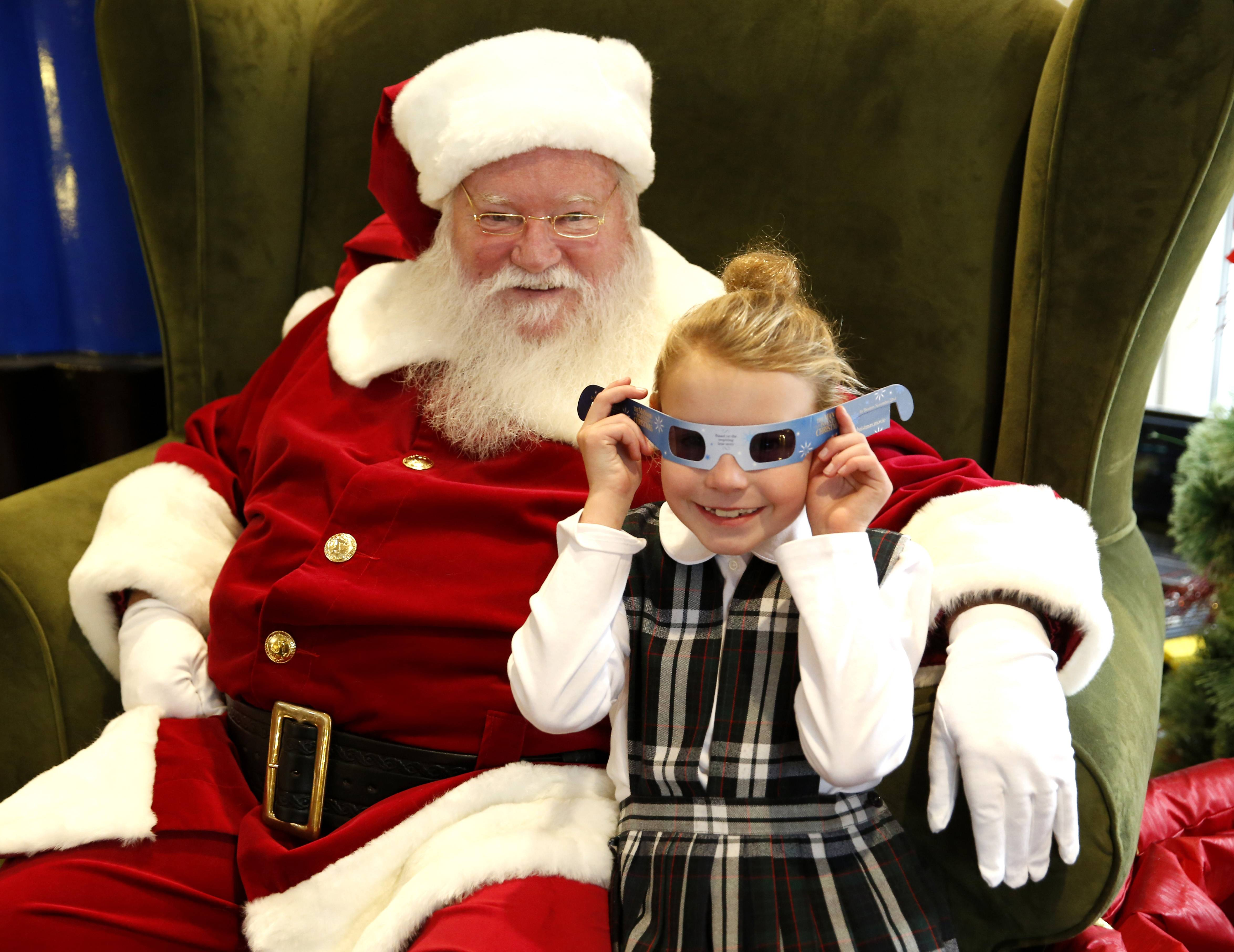Katelyn O'Toole, a 9-year-old who lives in LaGrange, visits Santa at Oakbrook Center.