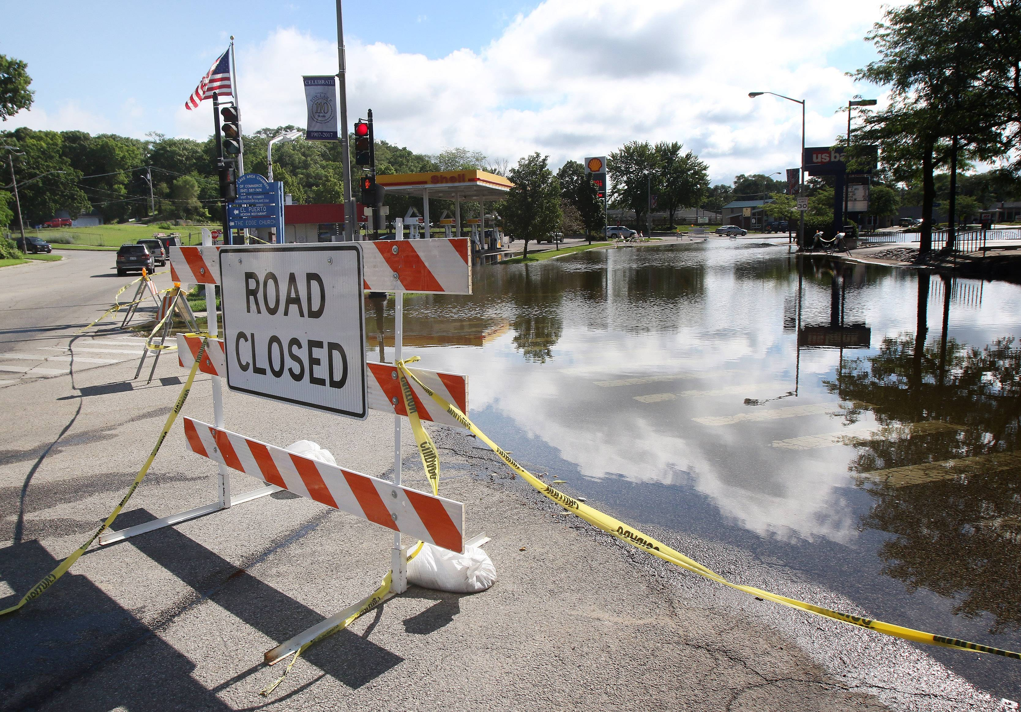 Gilbert R. Boucher II/gboucher@dailyherald.comGrand Avenue is closed after flooding in Fox Lake on Monday. The Chain O'Lakes is closed to boats and the downtown area has several streets closed due to high water.