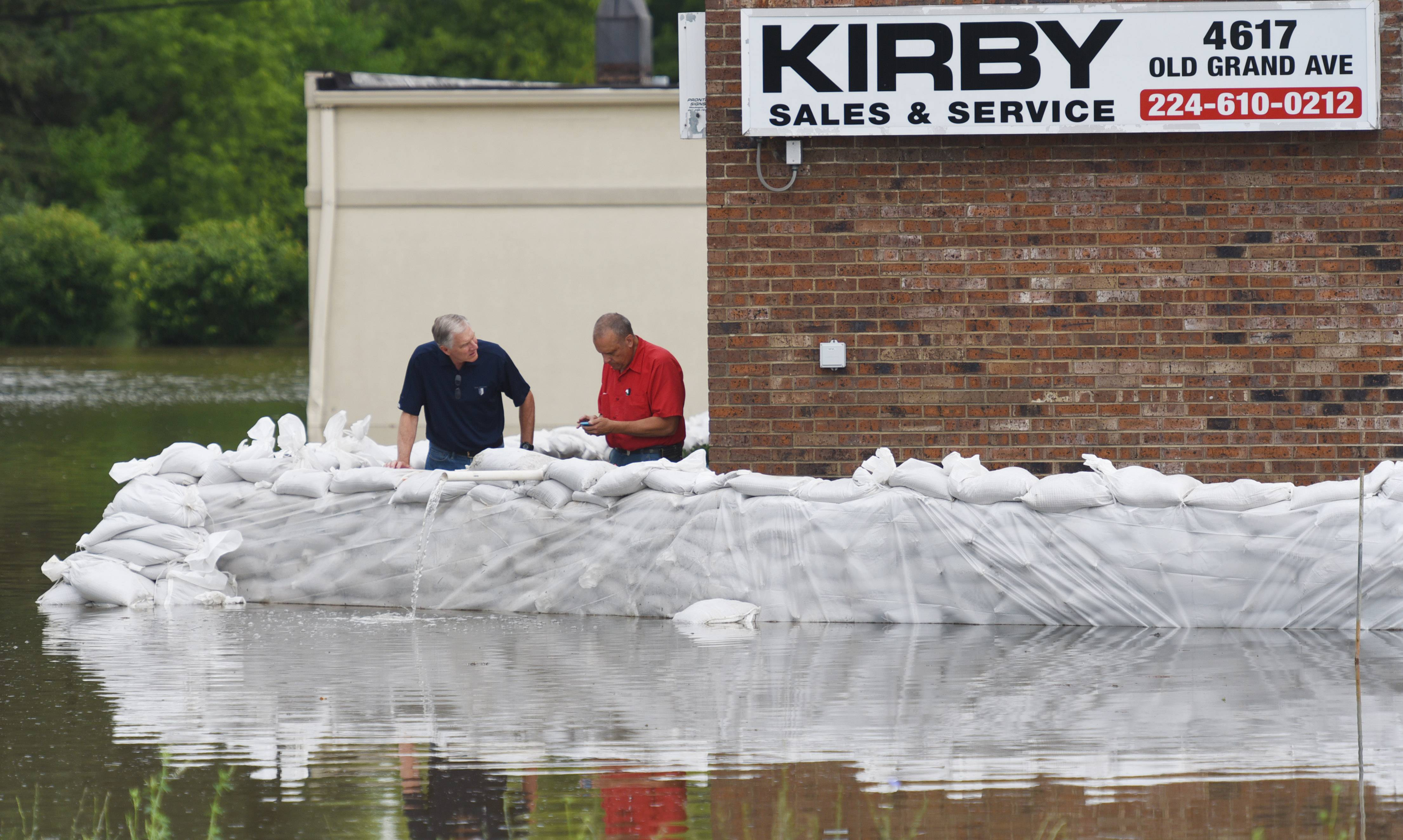 Paul Valade/pvalade@dailyherald.comSandbags protect businesses along Old Grand Avenuee in Gurnee Thursday.