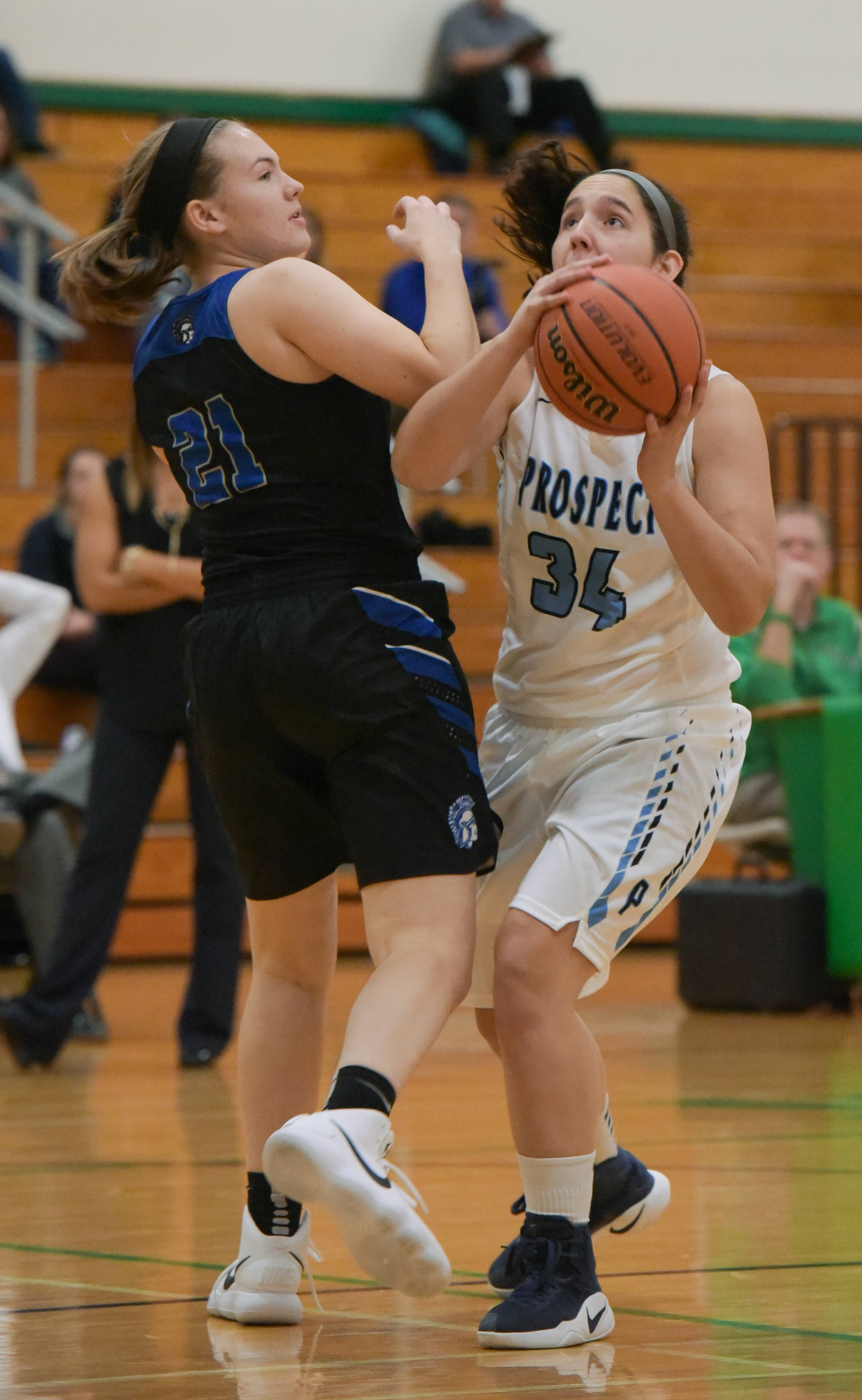 Prospect's Sara Biesterfeldt sets up for a shot over St. Francis' Meagan DeRaimo during the York Thanksgiving girls basketball tournament on November 13, 2017.