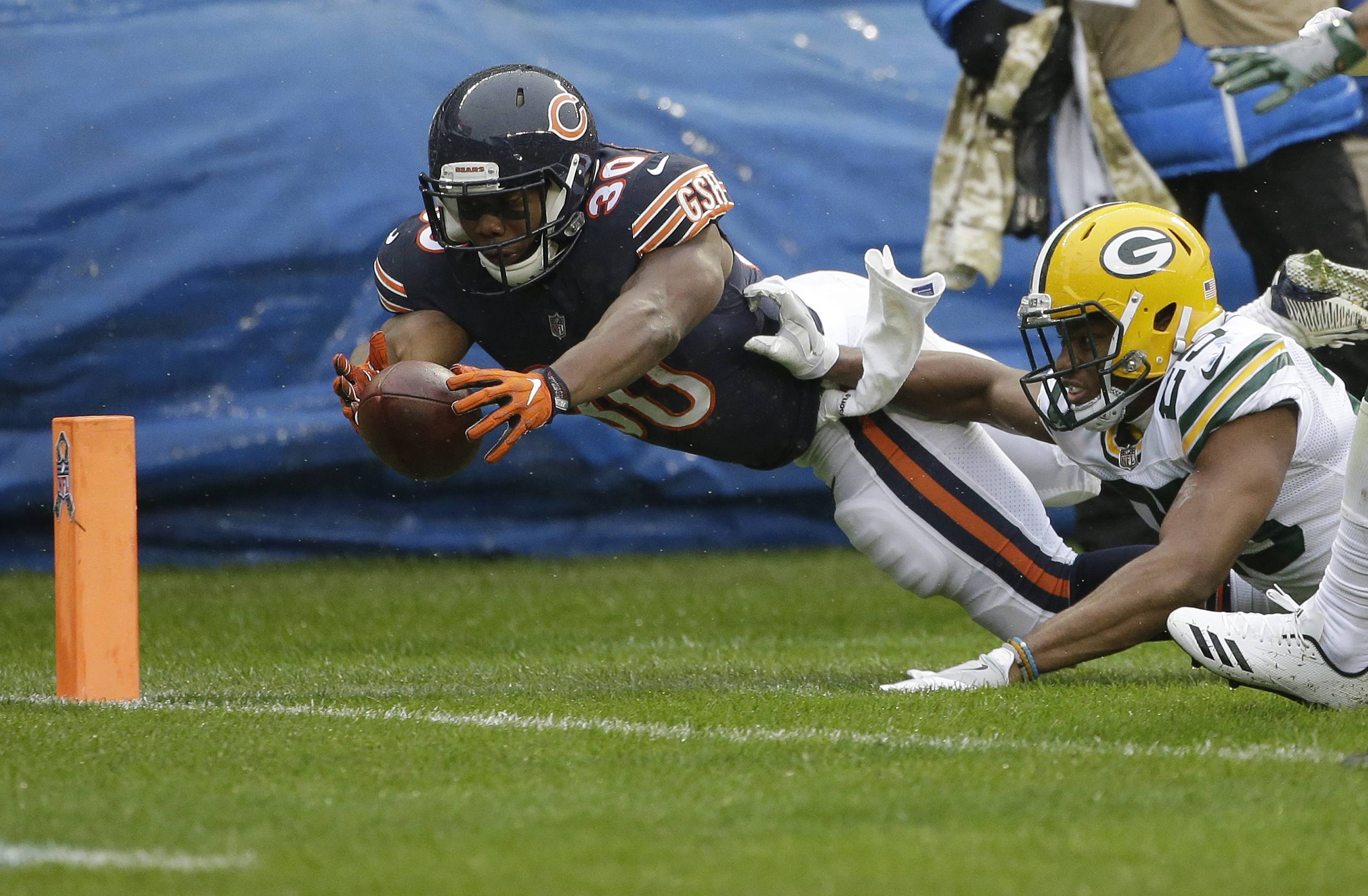 Chicago Bears running back Benny Cunningham (30) dives to the end zone against Green Bay Packers defensive back Marwin Evans (25) as Cunningham fumbles the ball during the first half of an NFL football game, Sunday, Nov. 12, 2017, in Chicago. (AP Photo/Nam Y. Huh)