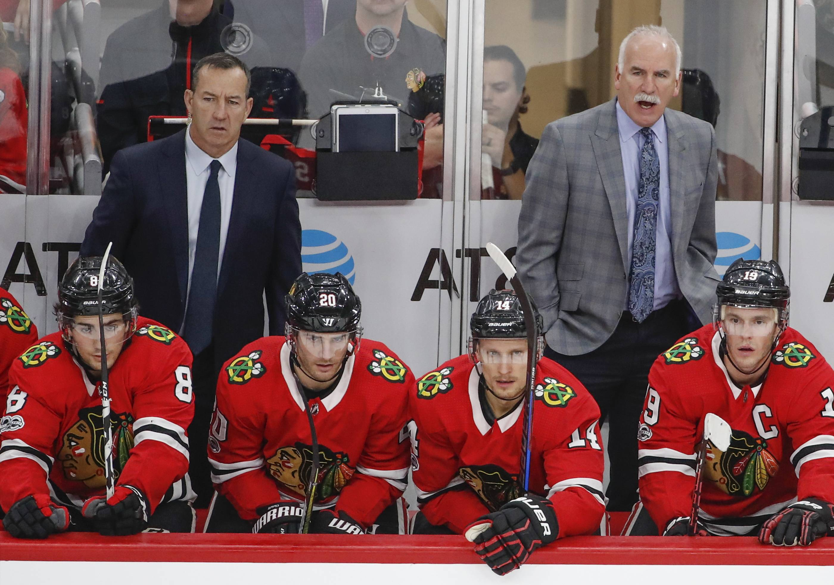 A move to wing for Nick Schmaltz, bottom left, has helped him get his confidence back and also has gotten the attention of Chicago Blackhawks coach Joel Quenneville, back right.