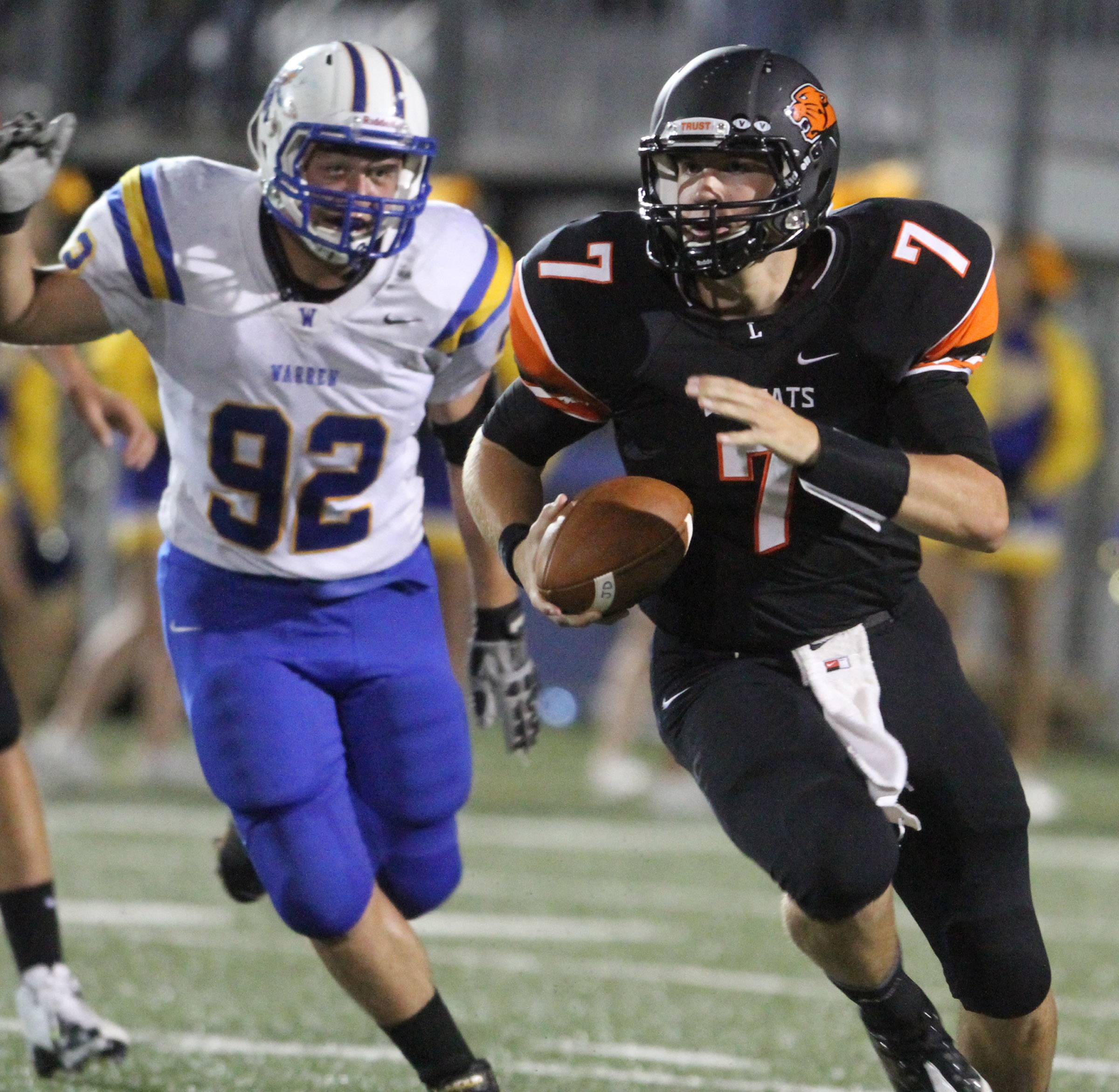 Libertyville's Jack Deichl, here playing QB and being pursued by Warren's Nick Orslini, is thriving as a tight end at Wisconsin-Whitewater.