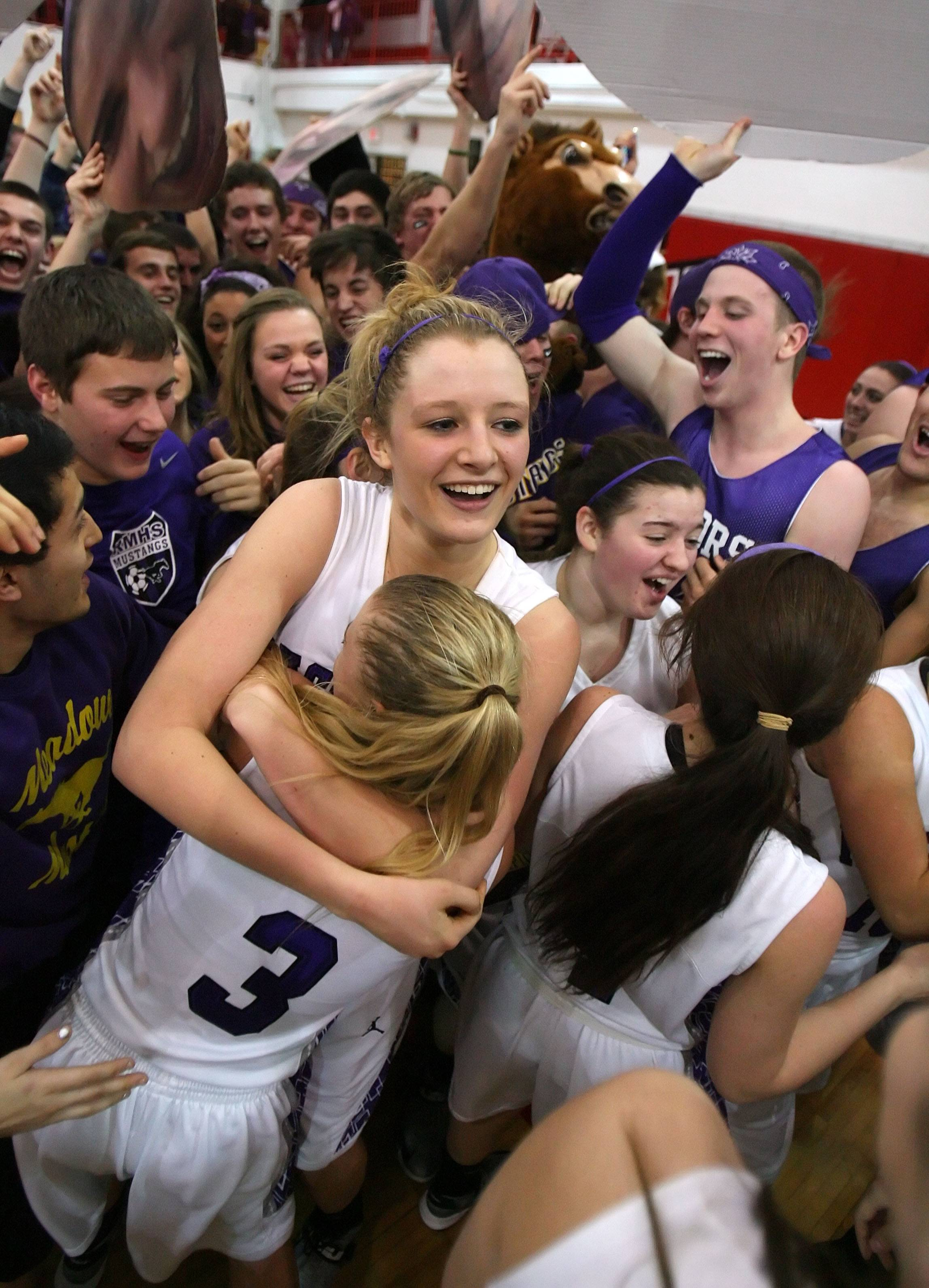 Rolling Meadows' Jenny Vliet and Jackie Kemph celebrate as the fans rush the floor after the Mustangs topped Evanston in the Class 4A Niles West supersectional in February, 2013. The two are still teammates, now for St. Louis University, and will compete this weekend at Wintrust Arena.