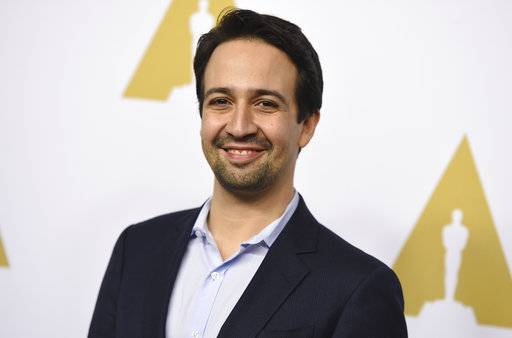 FILE - In this Feb. 6, 2017 file photo, Lin-Manuel Miranda arrives at the 89th Academy Awards Nominees Luncheon in Beverly Hills, Calif. Miranda will be honored Thursday at the Latin Grammys with the Latin Recording Academy President's Merit Award for his outstanding and numerous contributions to the Latin community. (Photo by Jordan Strauss/Invision/AP, File)