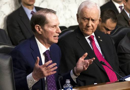 Sen. Ron Wyden, D-Ore., left, the top Democrat on the Senate Finance Committee, criticizes the Republican tax reform plan while Chairman Orrin Hatch, R-Utah, listens to his opening statement as the panel begins work overhauling the nation's tax code, on Capitol Hill in Washington, Monday, Nov. 13, 2017. The legislation in the House and Senate carries high political stakes for President Donald Trump and Republican leaders in Congress, who view passage of tax cuts as critical to the GOP's success at the polls next year.