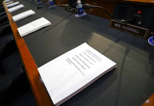 Copies of the Finance Committee Markup are placed for each member of the Senate Finance Committee before the start of the hearing as the tax-writing panel begins work on overhauling the nation's tax code, on Capitol Hill in Washington, Monday, Nov. 13, 2017. The legislation in the House and Senate carries high political stakes for President Donald Trump and Republican leaders in Congress, who view passage of tax cuts as critical to the GOP's success at the polls next year.