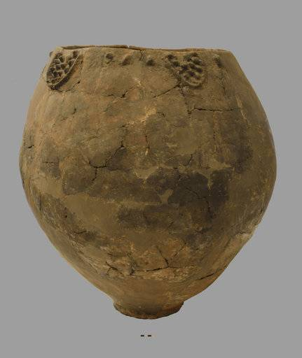 This undated photo provided by the National Museum of Georgia in November 2017 shows a Neolithic pottery vessel about 3 feet wide and 3 feet tall. Researchers announced Monday, Nov. 13, 2017, they have found shards of similar vessels, about 8,000 years old, south of Tblisi, Georgia. Patrick McGovern of the Penn Museum in Philadelphia says the pieces had come from the base of jars that were probably used for fermentation and storage of wine. (National Museum of Georgia via AP)