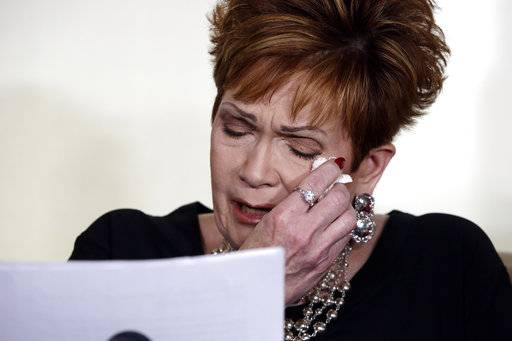"Beverly Young Nelson, the latest accuser of Alabama Republican Roy Moore, reads her statement at a news conference, in New York, Monday, Nov. 13, 2017. Nelson says Moore assaulted her when she was 16 and he offered her a ride home from a restaurant where she worked. Moore says the latest allegations against him are a ""witch hunt."""