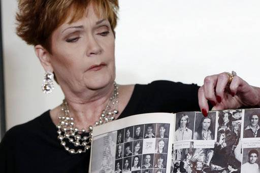 Beverly Young Nelson, the latest accuser of Alabama Republican Roy Moore, points to her photo in her high school yearbook during a news conference in New York, Monday, Nov. 13, 2017. Nelson says Moore assaulted her when she was 16 and he offered her a ride home from a restaurant where she worked.