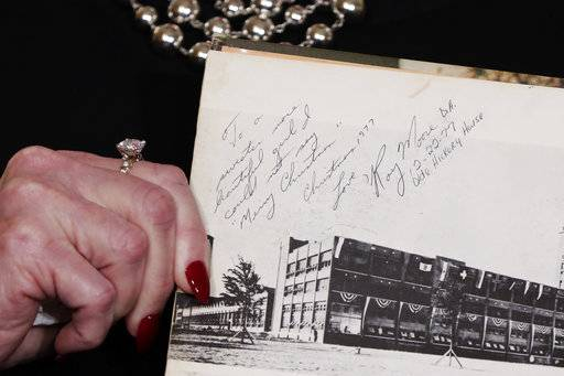 "Beverly Young Nelson the latest accuser of Alabama Republican Roy Moore, shows her high school yearbook signed by Moore, at a news conference, in New York, Monday, Nov. 13, 2017. Nelson says Moore assaulted her when she was 16 and he offered her a ride home from a restaurant where she worked. Anticipating Nelson's allegations at the news conference, Moore's campaign ridiculed her attorney, Gloria Allred, beforehand as ""a sensationalist leading a witch hunt."""