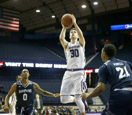 Northwestern 's Bryant McIntosh (30) shoots between St. Peter's guard Nick Griffin (0) and Julian Powell during the second half of an NCAA college basketball game Monday, Nov. 13, 2017, in Rosemont, Ill. Northwestern won 75-66. (AP Photo/Charles Rex Arbogast)