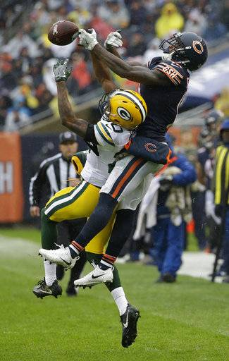 Green Bay Packers cornerback Kevin King (20) breaks up a pass intended for Chicago Bears wide receiver Josh Bellamy (15) during the first half of an NFL football game, Sunday, Nov. 12, 2017, in Chicago. (AP Photo/Nam Y. Huh)