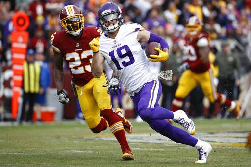 Minnesota Vikings wide receiver Adam Thielen (19) carries the ball past Washington Redskins free safety DeAngelo Hall (23) during the first half of an NFL football game in Landover, Md., Sunday, Nov. 12, 2017. (AP Photo/Patrick Semansky)