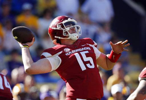 Arkansas quarterback Cole Kelley (15) throws a pass in the second half of an NCAA college football game against LSU in Baton Rouge, La., Saturday, Nov. 11, 2017. LSU won 33-10. (AP Photo/Gerald Herbert)