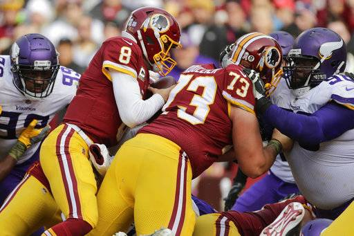Washington Redskins quarterback Kirk Cousins (8) dives through the line on a keeper for a touchdown during the first half of an NFL football game against the Minnesota Vikings in Landover, Md., Sunday, Nov. 12, 2017. (AP Photo/Mark Tenally)