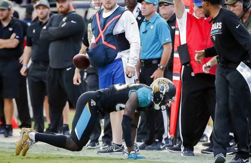 FILE - In this Nov. 12, 2017, file photo, Jacksonville Jaguars wide receiver Allen Hurns (88) crawls off the field after being injured on a pass reception during the second half of an NFL football game against the Los Angeles Chargers in Jacksonville, Fla. The Jaguars will be without Hurns at winless Cleveland on Sunday, Nov. 19, 2017, a potentially significant setback for a team already playing without Allen Robinson. (AP Photo/Stephen B. Morton, File)