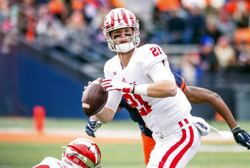 Indiana quarterback Richard Lagow (21) looks for a receiver during the second quarter of an NCAA college football game against Illinois, Saturday, Nov. 11, 2017, at Memorial Stadium in Champaign, Ill. (AP Photo/Bradley Leeb)