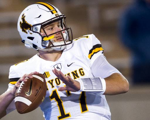Wyoming quarterback Josh Allen (17) warms up as they face off against Air Force in an NCAA college football game in Colorado Springs, Colo., Saturday Nov. 11, 2017. (Dougal Brownlie/The Gazette via AP)
