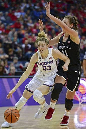 Connecticut's Katie Lou Samuelson drives on Stanford's Alanna Smith during the fourth quarter of an NCAA college basketball game, Sunday, Nov. 12, 2017, in Columbus, Ohio. Connecticut won 78-53. (AP Photo/David Dermer)