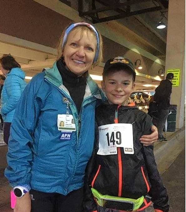 Race director Juli Aistars, left, Northwest Community Healthcare lung cancer patient navigator, poses with 13-year-old Edward Nieman of Palatine, who won first place in the One-Mile Run at the inaugural Pairing Up to Beat Lung Cancer event.