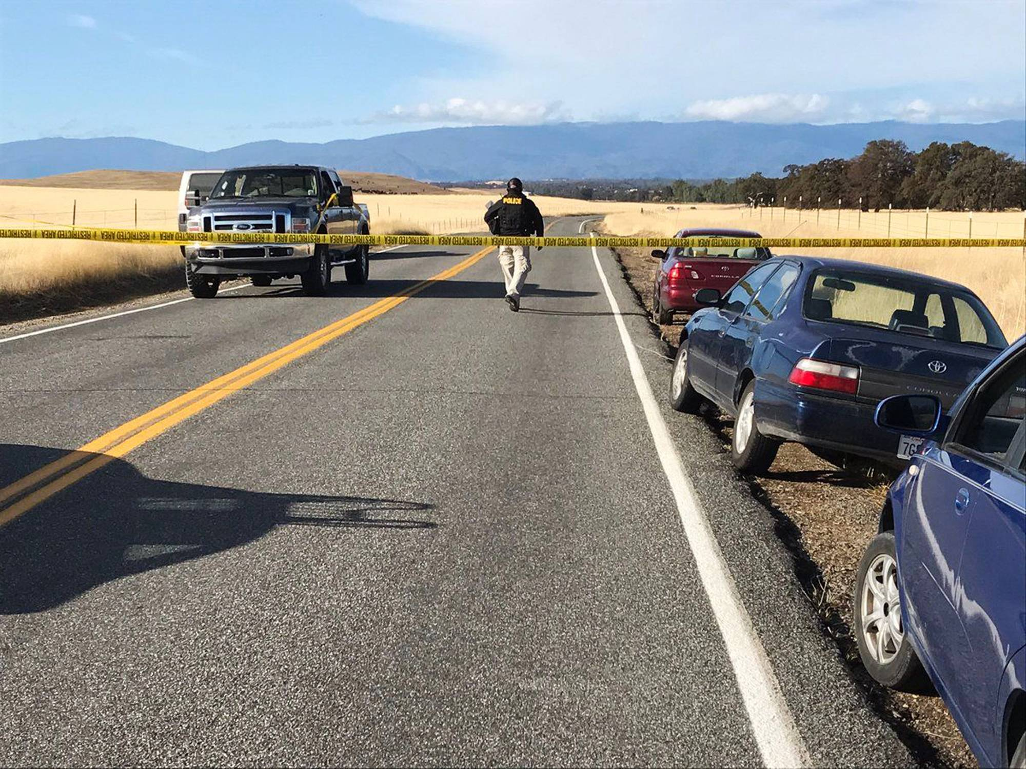 Crime tape blocks off Rancho Tehama Road leading into the Rancho Tehama subdivision south of Red Bluff, California, following a fatal shooting on Tuesday.